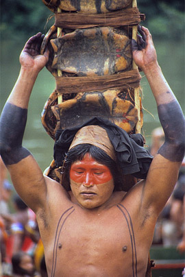 Kayapo man returning from a month long hunting trip