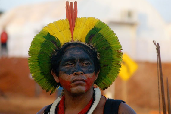 An indigenous man observes the occupation of the Belo Monte Dam construction site