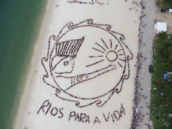 human banner on rio beach at rio+20