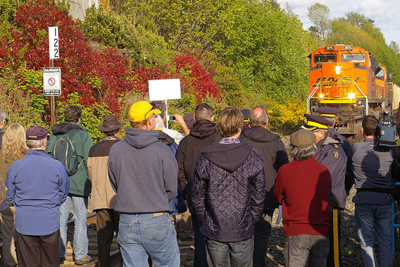 In British Colombia a group of concerned residents, along with scientists, blocked four trains of Wyoming coal bound for Asia. Thirteen were arrested. Photo courtesy of: 350.org.