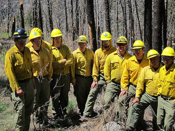New Mexico firefighters gather to highlight the connection between megafires in their state and climate change. The photo was taken as apart of 'Connect the Dots' day organized by 350.org. It must be noted that this photo was taken a few weeks before the megafire in the Gila National Forest, which is now New Mexico's worst. Photo courtesy of: 350.org.