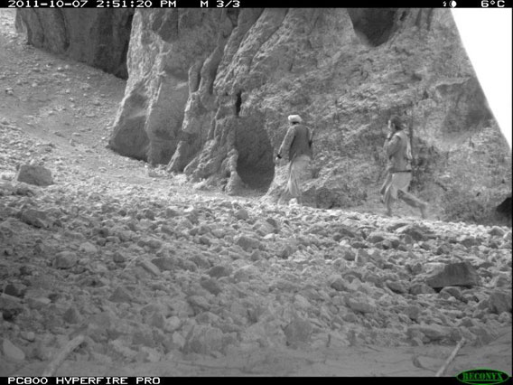 A pair of poachers caught by camera trap. Unsustainable hunting is a threat to many of Afghanistan's wildlife. Photo by: WCS Afghanistan Program.