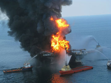 Platform supply vessels battle the blazing remnants of the off shore oil rig Deepwater Horizon. A Coast Guard MH-65C dolphin rescue helicopter and crew document the fire aboard the mobile offshore drilling unit Deepwater Horizon, while searching for survivors. Multiple Coast Guard helicopters, planes and cutters responded to rescue the Deepwater Horizon's 126 person crew. Photos by U.S. Coast Guard.