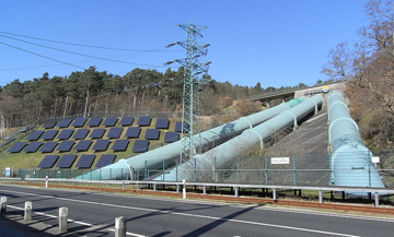 Energy park in Germany: solar on the left, hydro on the right.  Photo by: Quartl.