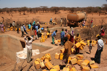 Oxfam distributing water in southern Somalia during last years famine. Photo by: Oxfam.