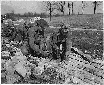 Building a road for the Civilian Conservation Corps in the U.S. in 1933. Photo courtesy of: Franklin D. Roosevelt Library and Museum.