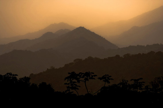 Sunset over the Sierra Nevada de Santa Marta in Colombia. This site is the last remaining refuge of 13 highly threatened species, but also provides many benefits to people. For example, the river basins are a very important source of clean freshwater to downstream human populations, and the tropical rainforest store a significant amount of carbon important for climate change mitigation. The site also has considerable cultural value as about 30,000 indigenous people of four ethnic groups are living in the area and consider it sacred. Photo © Robin Moore/iLCP.