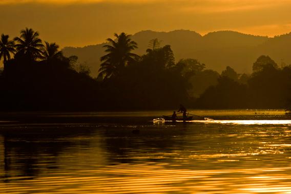 Chi Phat's main river at sunset. Photo courtesy of Suwanna Gauntlett.