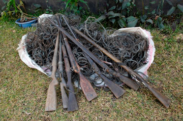 Collected rifles and snares by COMACO. Photo by: Julie Larsen Maher/WCS.