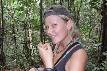 Kara with a tiny Brookesia chameleon, SE Madagascar. Photo courtesy of Kara Moses.