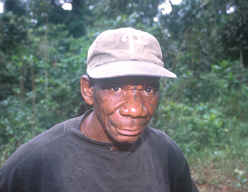 Monyaka is a typical pygmy elephant poacher. Monyaka has killed well over 100 elephants, worth thousands of dollars in ivory. Mostly he was paid in either alcohol or cigarettes for his ivory. Photo by: Stephen Blake.