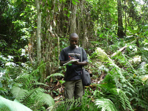 Taking down data in the field. Photo courtesy of ESI.