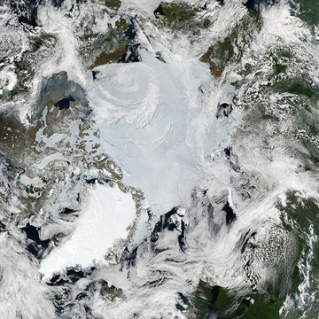 The Arctic as viewed by NASA's MODIS Satellite in June 2010. Greenland is the bright island on the bottom-left.