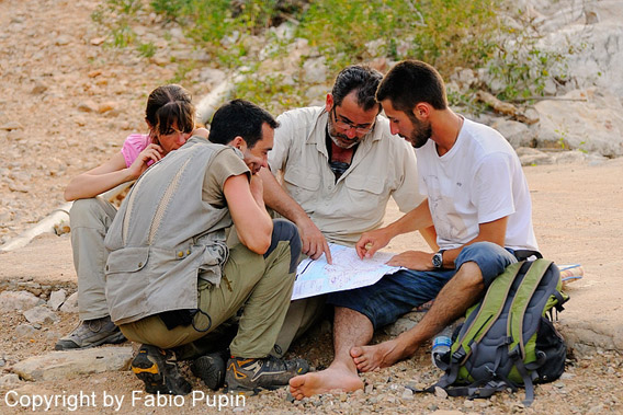 Researchers selecting survey sites in the field. Photo by: Fabio Pupin.