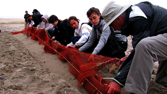 Children in Patagonia who help with the release of birds captured for ringing.
