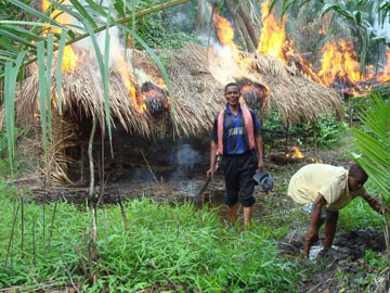 Rangers burn poachers' camp. Photo by: Zoological Society of Milwaukee (ZSM).