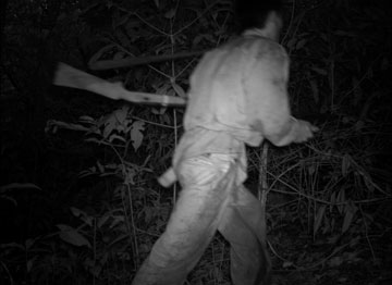 Poacher caught on camera in Nam Kading in Laos. Of the sites researched, this one presented the lowest number of species diversity and the highest habitat fragmentation. Photo courtesy of Wildlife Conservation Society, a member of the TEAM network.