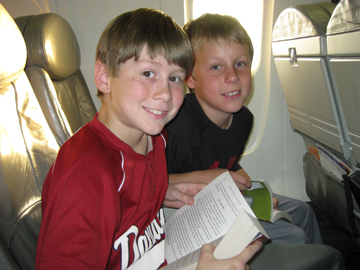 Cole and Liam on the airplane out to Louisville, Kentucky. Photo by: Kerry Rasenberger.