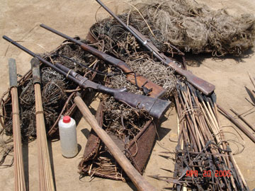Confiscated weapons from poachers. Photo by: Zoological Society of Milwaukee (ZSM).