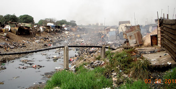 The trash nightmare of the Agbogbloshie Channel, which joins the Odaw Channel farther up. Photo by: Kwei Quartey.