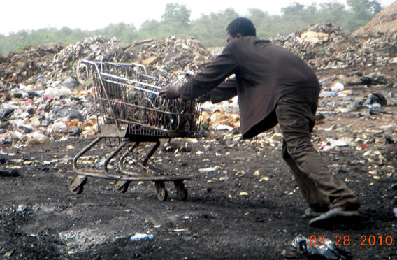 A boy pushing a shopping cart load of wires going for burning in the Agbogbloshie ghetto in Accra, Ghana. Photo by: Kwei Quartey.