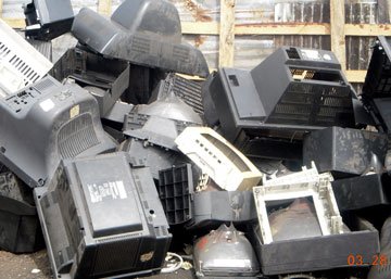 Piles of discarded TV carcasses and a CRT. Photo by: Kwei Quartey.