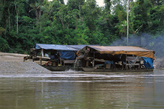 Boats used in artisanal gold mining. Photo by: Frank Hajek.
