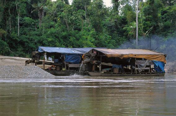 Boats used in artisanal gold mining. Photo by: Frank Hajek.