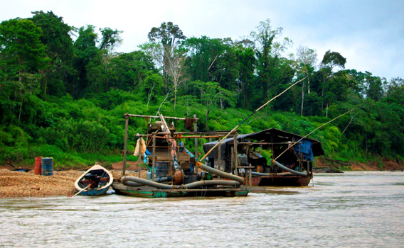 Illegal gold mining boat in Peru. Photo courtesy of Katy Ashe.