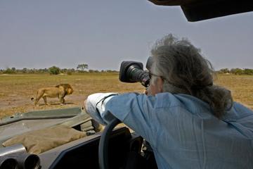 Dereck Joubert filming. © National Geographic Entertainment. Photo by: Beverly Joubert..