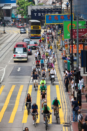 Bikes far outnumber cars in bike parade in Hong Kong. Photo by: Jason Findley