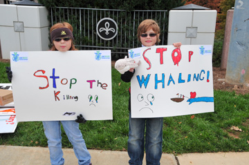 Carter and Olivia with their Anti-Whaling signs as they supported the organization Sea Shepard during their Anti-Whaling campaign in Atlanta, Georgia.