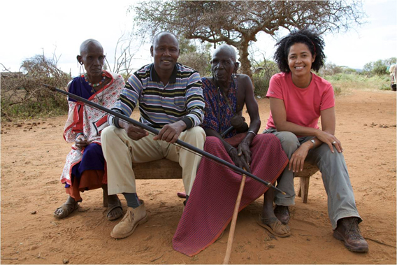 From the story 'The Glutton.' Paula (far right) in the field with Moses, Yetuni, and Stefano Cassini filming them. 37-year-old Moses Lekina (second from the left) and his father Yetuni Lekina (second to the right) are Maasai pastoralists living in a remote homestead in Kajiado near Mt Kilimanjaro. Moses' grandfather was legendary man who lived with wildlife and shared his food with lions not people, earning the nickname 'the glutton.' Africa's Wildest Stories honors our elders by listening to and capturing their stories. Most African elders are not literate and cannot write down their own stories. Photo courtesy of Paula Kahumbu.