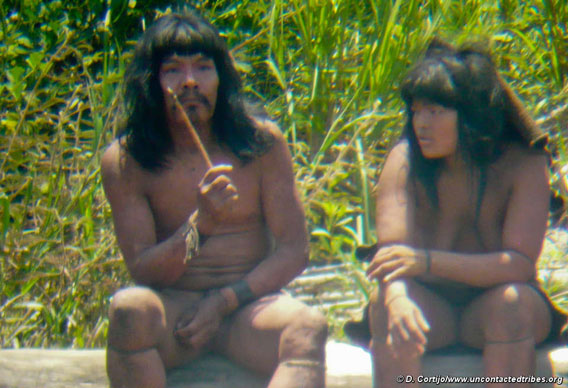 This Mashco-Piro man is holding a wooden-handled knife tipped with a capybara tooth.