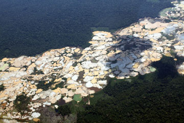 Aerial view of Amazon rainforest landscape scarred by open pit gold mines. Photo by: Rhett A. Butler.