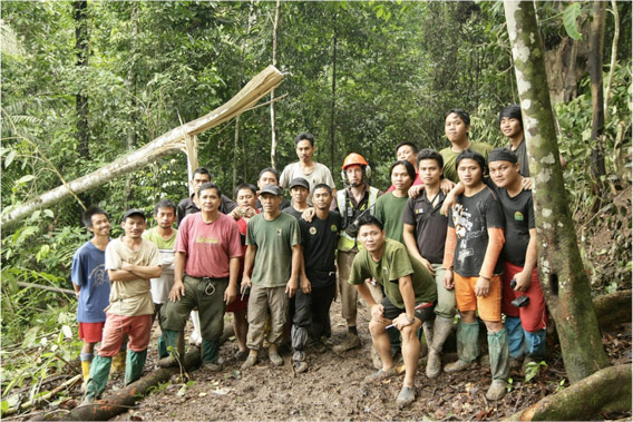 Rhino heroes: having run out of food except for instant noodles, the trap site team pose for a photo before the airlift on morning of 25 December 2011. Photo by: © Azrie Alliamat/ITBC, Universiti Malaysia Sabah.