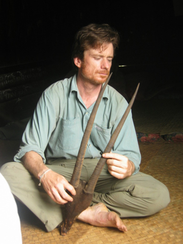 William Robichaud in the Annamite Mountains with saola horns. Photo courtesy of William Robichaud.