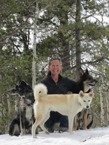 Bexell with dogs Darwin, Weiba, and Dahei. Photo courtesy of: Sarah Bexell.