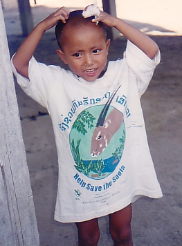 Local boy sporting saola conservation shirt. Photo courtesy of William Robichaud.