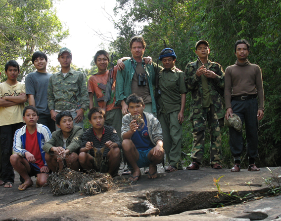 Survey team poses with snares (Robichaud is in the middle) in the Nakai-Nam Theun National Protected Area in the Annamite Mountains. Photo courtesy of William Robichaud.