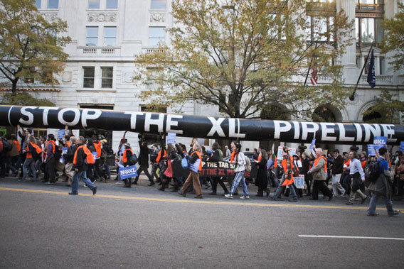 Around 12,000 protestors surrounded the White House, some carrying a symbolic pipeline. Photo by: Clayton Conn.
