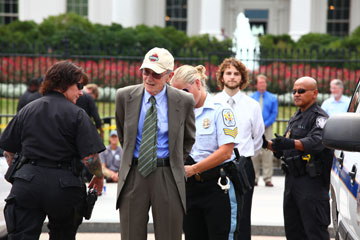 A man is arrested in front of the White House.